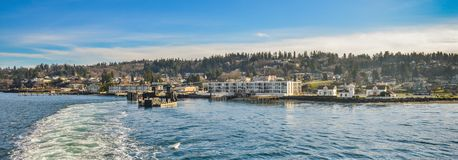 The City of Mukilteo in The Backdrop as Ferry Depart the Terminal Heading towards Whidbey Island on a Beautiful Winter Morning Royalty Free Stock Photos