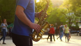 City music saxophone. Saxophone live at jazz on the street of town stock footage