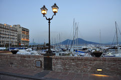 City of Naples, leisure marina and Vesuvius at dusk Stock Image