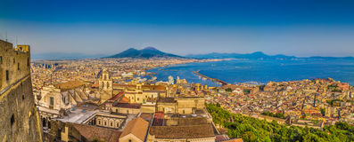 City of Naples with Mt. Vesuvius at sunset, Campania, Italy. Panoramic view of the city of Napoli (Naples) with famous Mount Vesuvius in the background in golden Royalty Free Stock Images