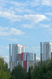 City and nature - modern high-rise buildings in the green trees Royalty Free Stock Photos