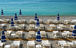 City of Nice - Beach with umbrellas Stock Images