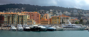 City of Nice, France - Harbour and port. NICE, FRANCE - APRIL 27: Colorful buildings and boats within a Port de Nice on April 27, 2013 in Nice, France. Port de Stock Photo