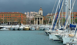 City of Nice, France - Harbour and port. NICE, FRANCE - APRIL 27: Colorful buildings and boats within a Port de Nice on April 27, 2013 in Nice, France. Port de Royalty Free Stock Photography