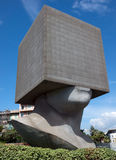 City of Nice - Square Head. NICE, FRANCE - JUNE 4, 2014: Square Head - building cube shaped as human head sculpture. Authors are sculptor Sacha Sosno and Royalty Free Stock Photography