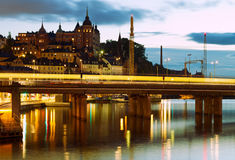 City at night. Bridge and buildings in Stockholm at night royalty free stock image