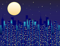 City at Night. City skyline at night with illuminated windows and a bright large moon Stock Photography