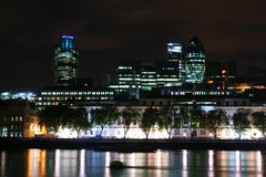City at night. A colourful photo of London at night with the river Thames Royalty Free Stock Images