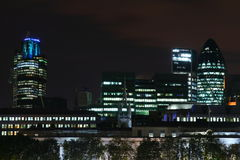 City at night. A colourful photo of London at night with the river Thames royalty free stock image