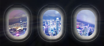 City at night through airplane window Royalty Free Stock Image