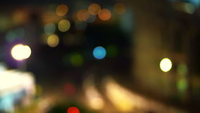 City night background blur busy street road and food stall view of Bangkok, Thailand stock footage