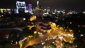 City at night background with cars. Out of focus background with blurry unfocused city lights. Ho Chi Minh, Vietnam.  stock video