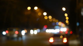 City at night background with cars. Out of focus. Background with blurry unfocused city lights stock footage