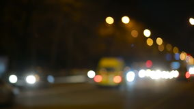 City at night background with cars. Out of focus. Background with blurry unfocused city lights stock video footage