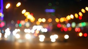 City at night background with cars. Out of focus background with blurry unfocused city lights. Moscow, Russia stock video footage