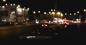 City at night background with moving cars. Out of focus background with blurry unfocused city lights. Defocused Night Traffic stock footage