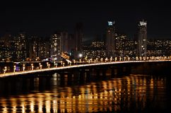City at night and bridge with lights Stock Photo