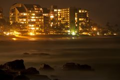 City at night on the coast line Royalty Free Stock Photography