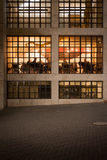 City at Night - Diners in Restaurant Cafe through Window Royalty Free Stock Images