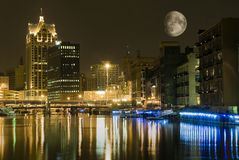 City at night with large moon. Milwaukee wisconsin at night, with clear visible moon Royalty Free Stock Photos