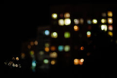 City night lights, not in focus horizontal. Glowing windows of houses at night in the city. The image is not in focus, beautiful bokeh royalty free stock photography