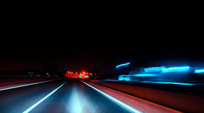 City night lights perspective blurred by high speed of the car. Royalty Free Stock Photography