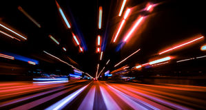 City night lights perspective blurred by high speed of the car. City colorful night lights perspective blurred by high speed of the car. A streak of light Stock Images