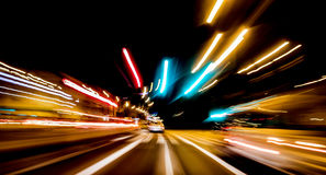 City night lights perspective blurred by high speed of the car. Royalty Free Stock Photo