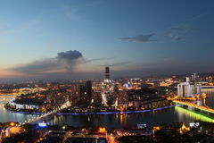 City night. City  night  lights  setting  sun  liuzhou  china  buildings  river's  bridge Stock Photos
