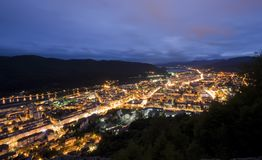 City at night in mountains. City in summer night, Piatra Neamt, Romania Royalty Free Stock Images