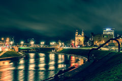 City at night with river reflections royalty free stock photography