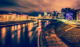 City at night with river reflections royalty free stock images