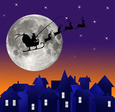 City at night. Santa on sky. Marry christmas Stock Images