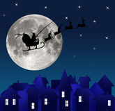 City at night. Santa on sky. Marry christmas Royalty Free Stock Photography
