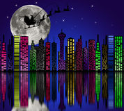 City at night. Santa on sky. Marry christmas Royalty Free Stock Photos