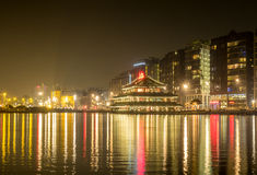 City night scene of Amsterdam with reflection Royalty Free Stock Photo