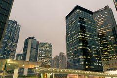 City night scene with business office skyscrapers in Hong Kong, Royalty Free Stock Photo