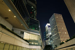City night scene with business office skyscrapers in Hong Kong, Stock Photo