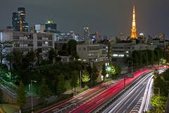 City night scene with car motion lights. City nights scene with car motion lights and Tokyo Tower on the background, Japan Stock Photography