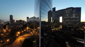 City night scenery of modern business buildings stock video