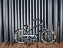 City night snapshot of a fashionable bicycle standing near a black sea container. Outdoor Royalty Free Stock Photo