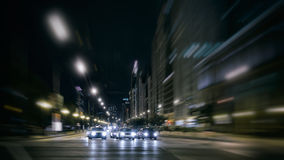 City Night Traffic on the Move. Traffic late at night in Chicago with Blur effect to elicit movement and draw attention to the cars as they begin crossing the Royalty Free Stock Images