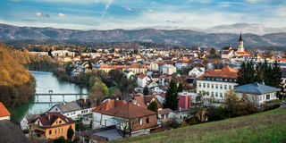 City  Novo mesto. Novo mesto Shot from the hill sees the whole city with the river Krka, the church  bell tower and mountains in the background Stock Image