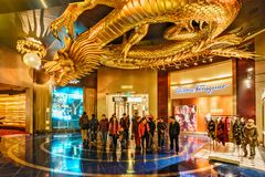 City Of Dreams Casino Interior In Macao. Metal Sculpture Of Golden Dragon Chasing Flaming Pearl Stock Image