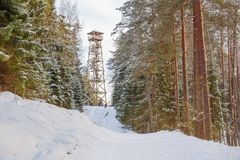 Old sand quarry and tower at city Ogre. Travel photo. 2018. City Ogre, Latvia. Peoples and old sand quarry at city Ogre. Snow and ice, nature photo. Travel photo Royalty Free Stock Image