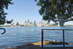 City and opera house across the harbour Stock Photo
