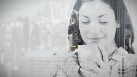 City overlay on woman drinking coffee stock video
