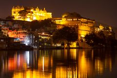 City Palace and Pichola lake at night, Udaipur Stock Photos