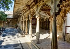 City Palace at the Pichola Lake in Udaipur in Rajasthan, India. City Palace at the Pichola Lake in Udaipur, Rajasthan, North India stock images