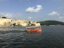 City palace udaipur. Boats clouds udaipur Royalty Free Stock Photo